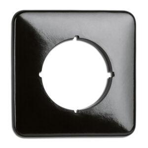 Kvadratisk, sort bakelitramme til stikkontakter og afbrydere